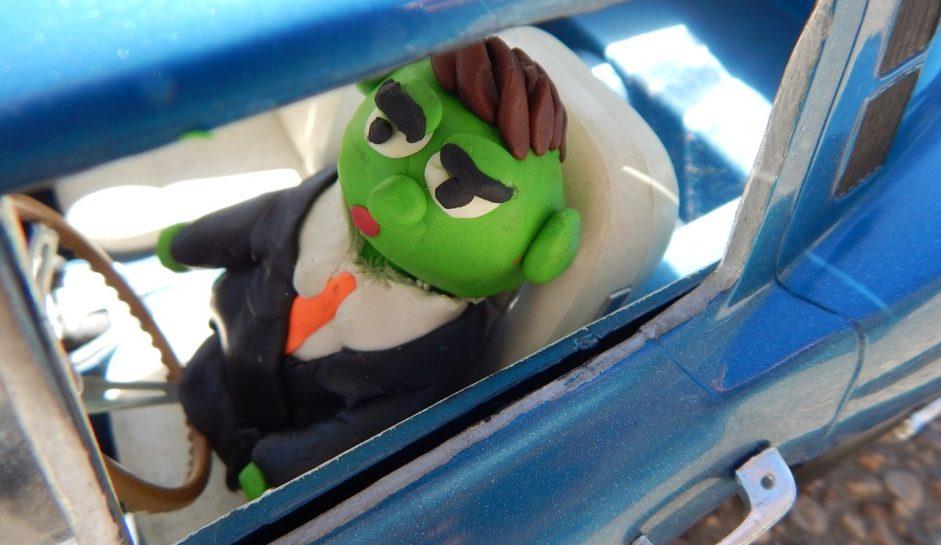 Plasticine man in car